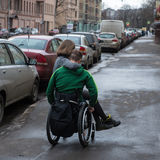 A disabled young man  in a wheelchair with  girl Stock Images