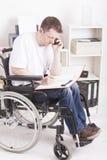 Disabled young man at work Royalty Free Stock Photos