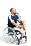 Disabled young tennis player sitting in wheelchair and looking up Royalty Free Stock Photo