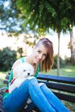 Disabled young woman with dog royalty free stock photos