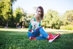 Disabled young woman with dog royalty free stock images
