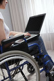 Disabled young woman using laptop Stock Photos