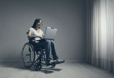 Disabled young woman using laptop Stock Images