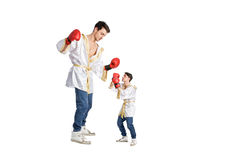 Disadvantage. Conceptual disadvantage photo showing giant against dwarf on white background Royalty Free Stock Photography