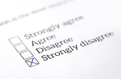 Disagree box checked in opinion poll, survey and questionnaire. stock photos