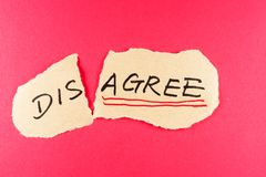 Disagree to agree. Concept words written on the paper against red background Royalty Free Stock Images