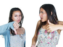 Disagreeing. Two women disagreeing with thumb gestures Royalty Free Stock Images