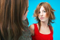 Disagreement. Closeup of two teenage girls, one with head turned toward the other.  Second girl is facing camera with serious expression Stock Images