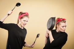 Kitchen fight between retro girls. Stock Photos