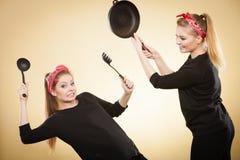 Kitchen fight between retro girls. Stock Photography
