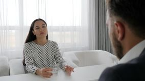 Disagreement in married couple, portrait of upset woman Seated at table at psychotherapist, dialog. Of secretary and boss in Office, Unnappe female talk about stock video