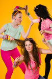 Disagreement. Three girlfriends fights, they hava a some disagreement Stock Photo