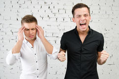 Disagreements. Two attractive guys. Two attractive guys in the studio. Business and education royalty free stock photos