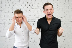 Disagreements. Two attractive guys. Two attractive guys in the studio. Business and education stock photos