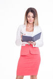 Disapointed business woman checking her agenda. Royalty Free Stock Photography