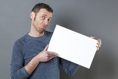 Disapointed man holding balnk white card for advert Royalty Free Stock Photography