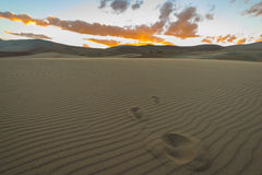 Disappeared footprints in the sand. And beautiful desert sunset Colorado Great Sand Dunes Royalty Free Stock Photo