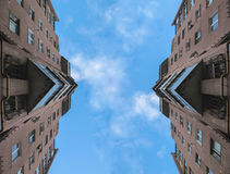 Disappearing buildings in the morning reflection abstract. Disappearing glass buildings in the morning, wide angle view, reflection abstract view Royalty Free Stock Photography