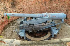 Disappearing carriage gun at Phi Sua Samut Fort, the public plac. E in Thailand. Disappearing carriage gun is an obsolete type of artillery which enabled a gun Royalty Free Stock Images