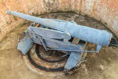 Disappearing carriage gun at Phi Sua Samut Fort, the public plac. E in Thailand. Disappearing carriage gun is an obsolete type of artillery which enabled a gun Royalty Free Stock Photography
