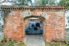 Disappearing carriage gun at Phi Sua Samut Fort, the public plac. E in Thailand. Disappearing carriage gun is an obsolete type of artillery which enabled a gun Royalty Free Stock Image