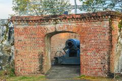 Disappearing carriage gun at Phi Sua Samut Fort, the public plac. E in Thailand. Disappearing carriage gun is an obsolete type of artillery which enabled a gun Royalty Free Stock Photo