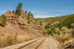 Disappearing Railroad Tracks. Railroad tracks in Montana disappearing around a curve on a spring day Royalty Free Stock Image