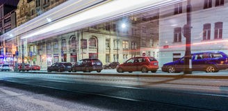 Disappearing tram on the street. Photo shows a street, cars and a tram that disappears due to long exposure time. Photo taken in Prague, Czech Republic Royalty Free Stock Photography