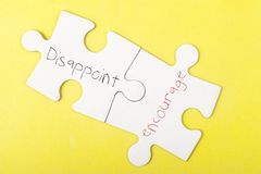 Disappoint and Encourage words Stock Images