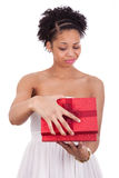 Disappointed African American woman opening a gift box Stock Images
