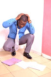 Disappointed African employee stock image