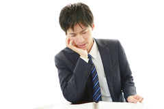 Disappointed Asian businessman Royalty Free Stock Images