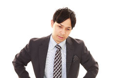 Disappointed Asian businessman royalty free stock photos
