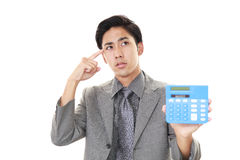 Disappointed Asian businessman royalty free stock photography