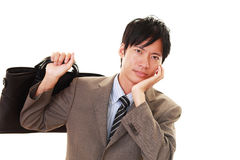 Disappointed Asian businessman Royalty Free Stock Photo