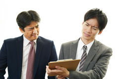 Disappointed Asian businessmen Stock Images
