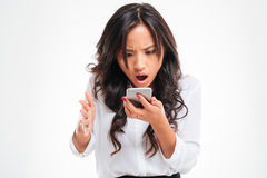 Disappointed asian businesswoman using smartphone Stock Photos