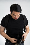 Disappointed Asian traveler Stock Photo