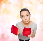 Disappointed asian woman with empty red gift box Stock Photos