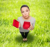 Disappointed asian woman with empty red gift box Stock Image