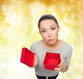 Disappointed asian woman with empty red gift box Royalty Free Stock Photography
