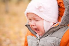 Disappointed baby stay in park Royalty Free Stock Images