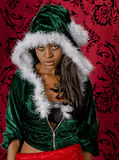 Disappointed Balck woman in a holiday sweater. A disappointed beautiful young black woman in a hooded christmas sweater pulls the hood back slightly revealing royalty free stock image