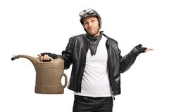 Disappointed biker holding an empty gas can. Isolated on white background royalty free stock images