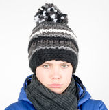 Disappointed boy with scarf and hat Royalty Free Stock Photos