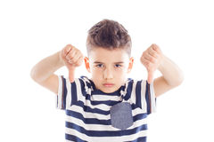 Disappointed boy with thumbs down royalty free stock images