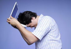 Disappointed boy with white notebook. Studios phot Stock Images
