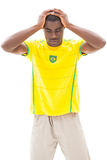 Disappointed brazilian football fan looking down Stock Photography