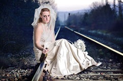 Disappointed bride on a railway Stock Images