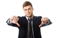 Disappointed business man with thumb down. Stock Photography